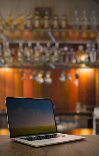 laptop on top of bar